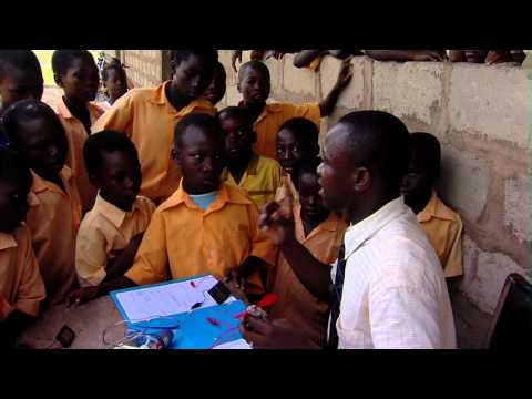 Royalty Free Stock Footage of Teacher teaching electricity to students in Africa.