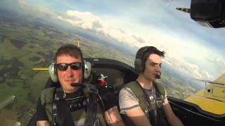 Friends in Small Arcraft doing Aerobatic Maneuvers