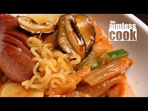 """Budae Jjigae Recipe - Korean Cooking, Budae Jjigae literally means """"Army Camp Stew"""" and was born from the ashes of the Korean War. Hungry locals would make this stew from whatever ingredients cou..."""