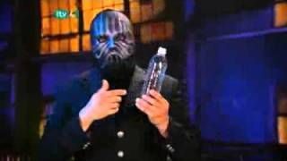Masked Magician Cell Phone Through The Plastic Bottle