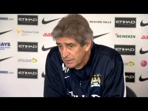 Manchester City's Manuel Pellegrini says Arsenal are tough rivals