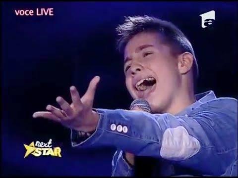 Valentin Poenariu, de 13 ani, din Mioveni, interpreteaza superb Je t'aime!