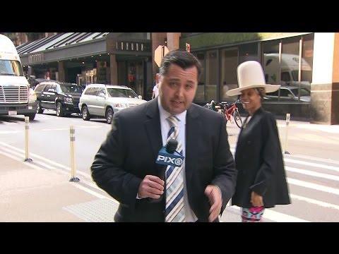Erykah Badu Interrupts Live Shot, Tries to Kiss Reporter