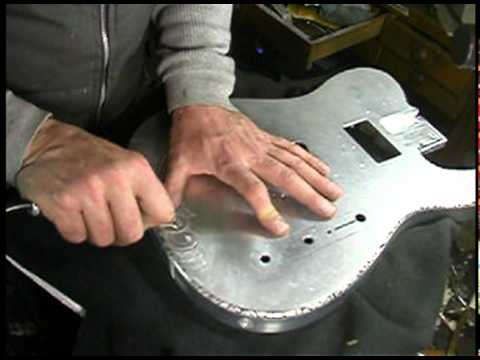 Warren Smith Engraving On A Liquid Metal Guitar