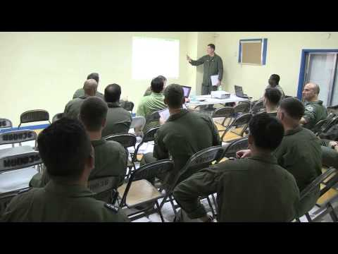 U.S. Service members, DoD Personnel and PAF participate in a live fly cell brief