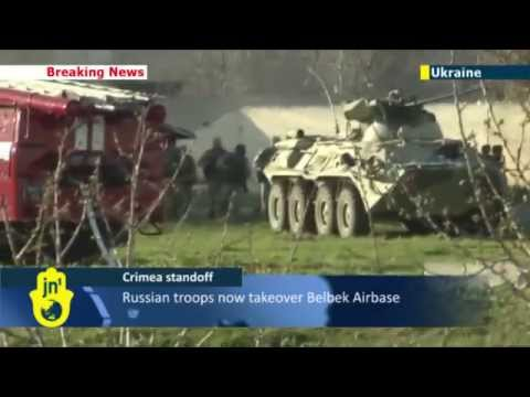Russians smash Crimea army base with tank