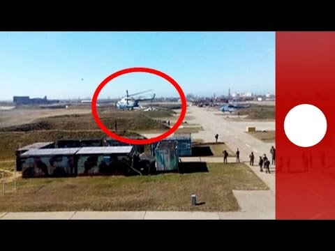 Video: Ukrainian pilots escape with aircraft as troops 'take over' air base