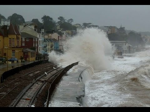 Dramatic scenes as huge waves batter Dawlish sea wall and station.Beach huts smashed.