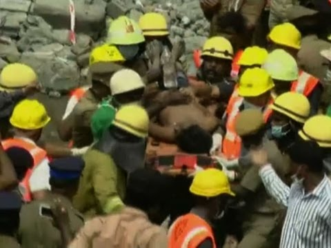Raw: Man Saved From Rubble of Collapsed Building