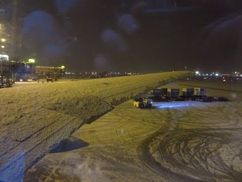 Air Canada Boeing 767-300ER cold engine startup + deicing + takeoff from Toronto under snowfall