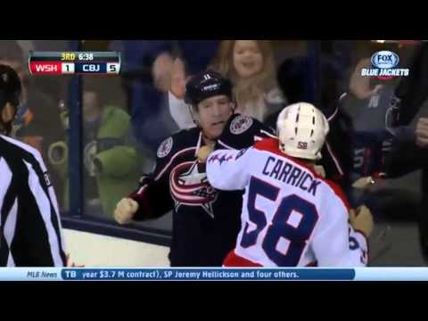 Connor Carrick v Matt Calvert : Washington Capitals v Columbus Blue Jackets : January 17 2014