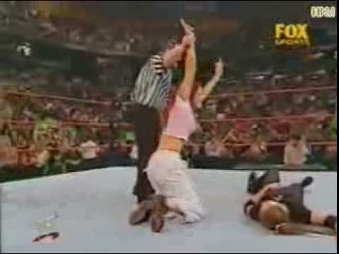 The Hardy Boyz and Lita vs Stone Cold, Triple H and Stephanie McMahon. (Lita get's assaulted.)