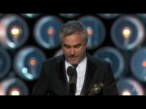 "Alfonso Cuarón ‪winning the Oscar® for Directing ""Gravity""‬"