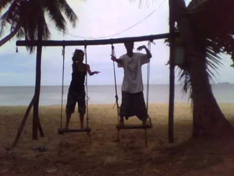 Swinging Macarena in Thailand beach