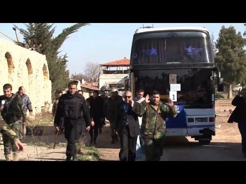 Civilians evacuated from Syria's besieged Homs