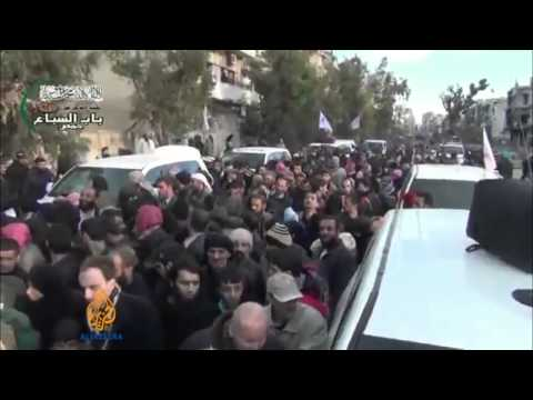 Homs evacuations resume amid fear