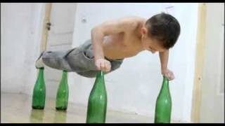 """World's Strongest Kid"" Does Push-Ups On Bottles"