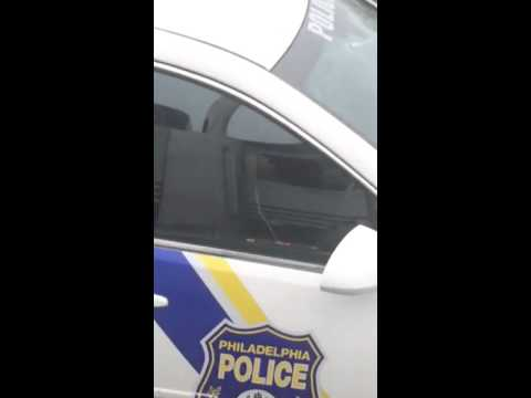 Philadelphia police officer texting while driving