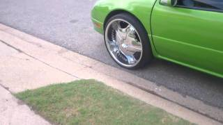 1999 Chrysler LHS sittin high on 24's with Candy Paint & Lambo Doors. Donk Status!!!
