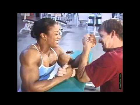 Kim Perez armwrestles against a smaller man
