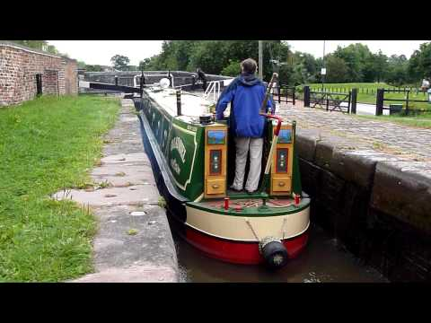 English Canal Barge going through a Lock in Stone Staffordshire August 2010 by Workhouse Bridge