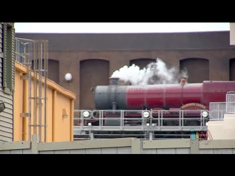 Hogwarts Express train leaving Diagon Alley in Wizarding World of Harry Potter at Universal Orlando