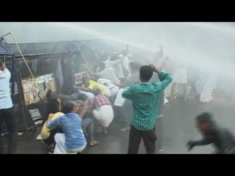 Indian police use water cannons and tear gas on protesters