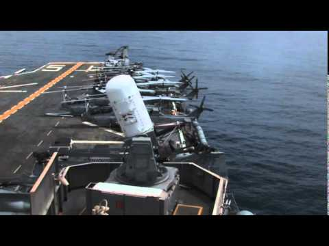 Phalanx CIWS Gun Firing from US Amphibious Assault Ship Close in Weapon System Gatling Gun in Action