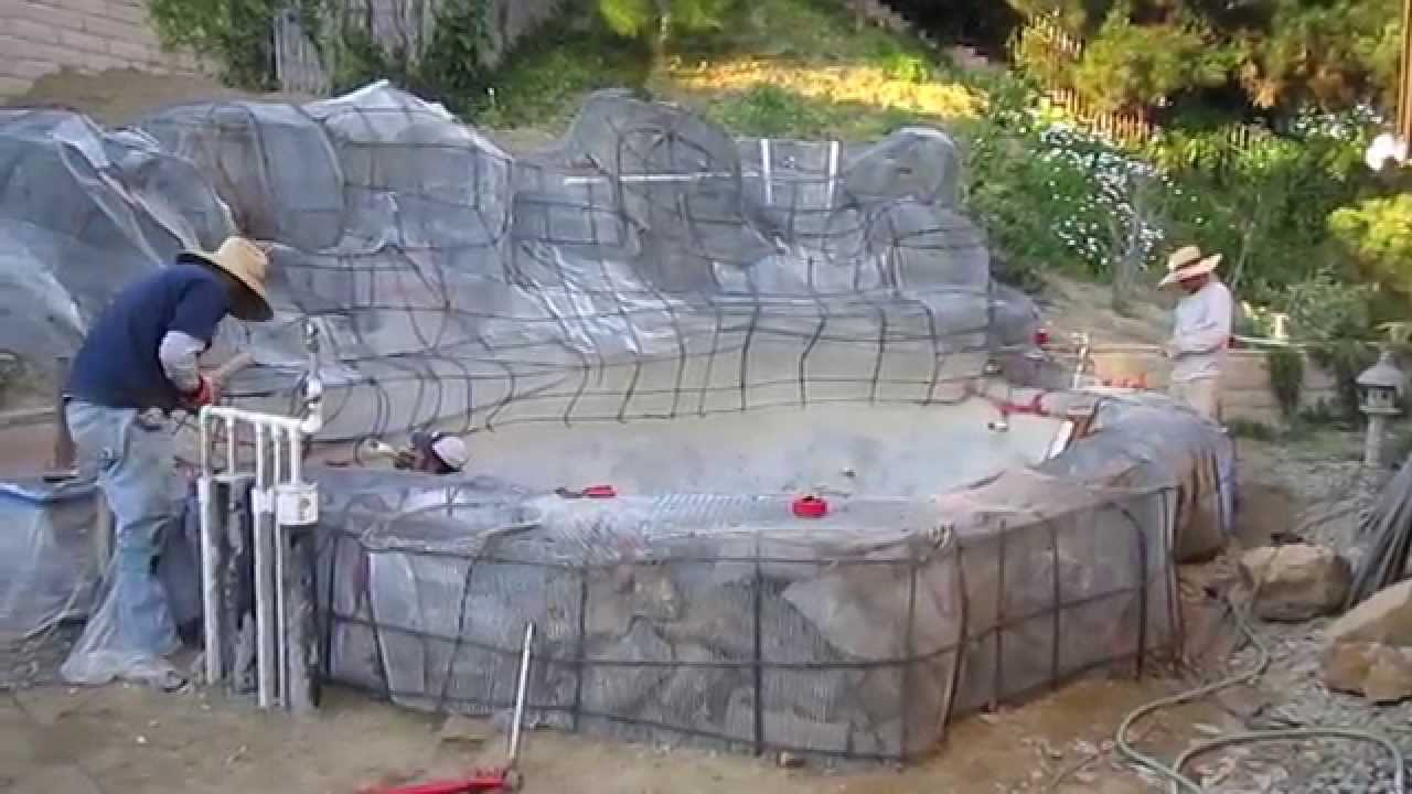 Koi pond construction part 5 faux artificial boulders for Artificial fish pond
