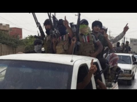 Iraq crisis: Victorious ISIL fighters parade through Mosul streets