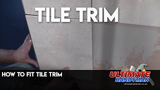 Installing tile trim on a out of level wall