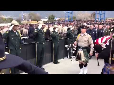 RAW VIDEO: The casket of Jeremiah MacKay is escorted into the funeral