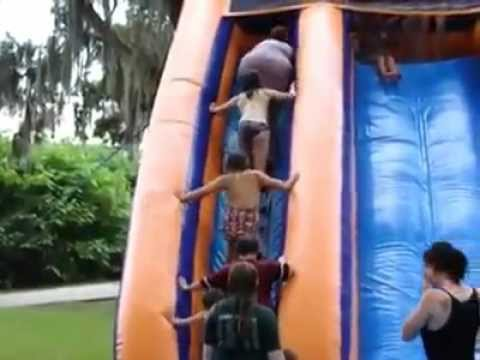 Fat woman falls down steps & wipes out a line of kids