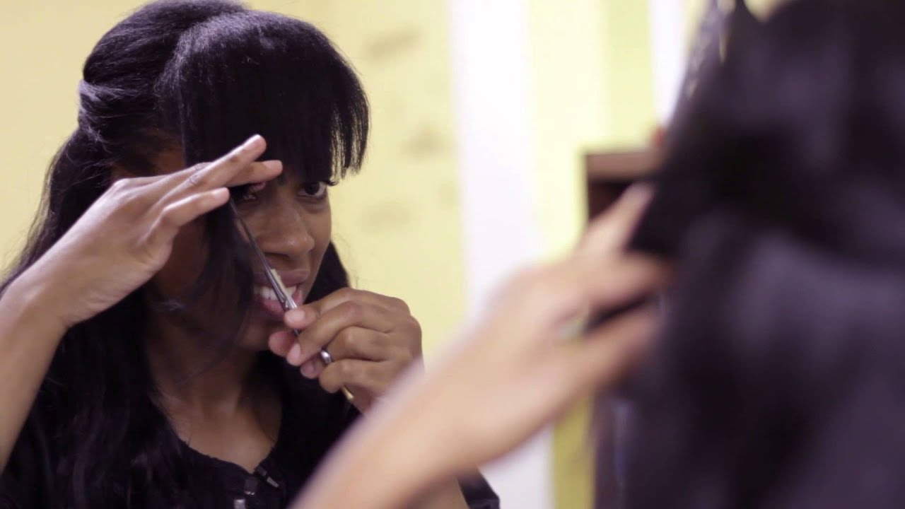 how to cut long bangs yourself