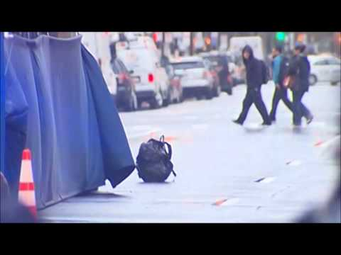 Boston Marathon Finish Line Evacuated - Masked Man Drops Backpack