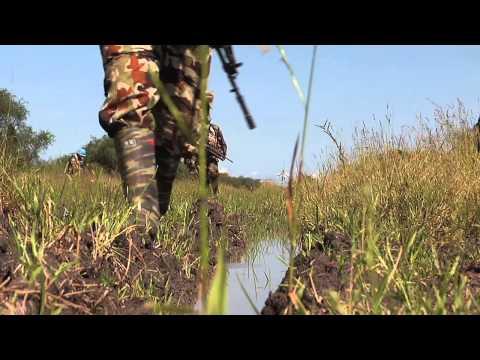 UNMISS Troops Foot Patrol in Muddy Terrain