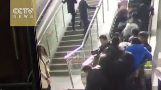 Exclusive Footage: People thrown to the ground by a reversing escalator