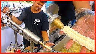 Street food - Magic Making Machine Doughstick with Teh Tarik in Dessert Event