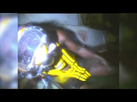Raw: Divers Find Man Alive in Sunken Tugboat - YouTube