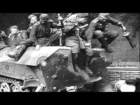 Russian troops riding on captured German half-track in a German town, at end of W...HD Stock Footage