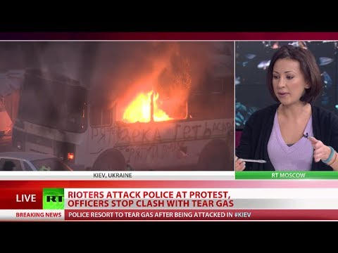Clashes erupt in Kiev as thousands defy protest ban