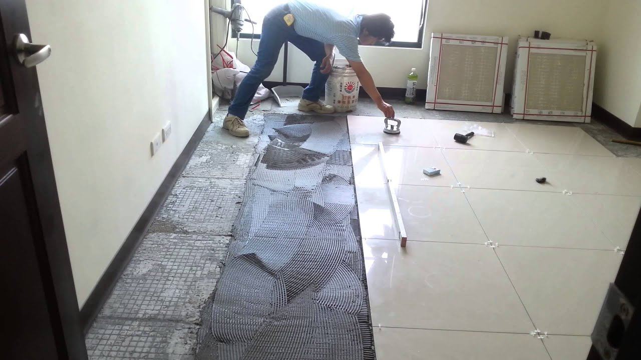 Laying tiles on floor