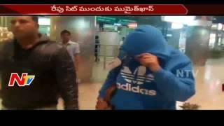 Mumaith Khan reaches Hyderabad from Pune; hides her face..