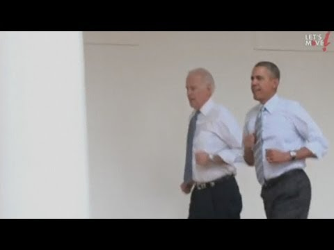 Barack Obama and Joe Biden run round the White House