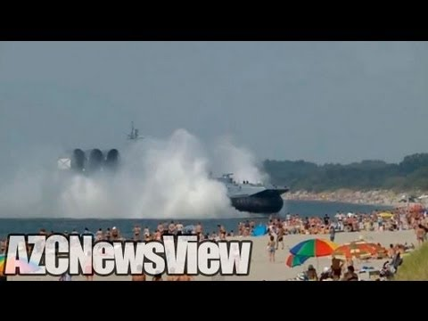 Russian Navy Hovercraft Lands On Busy Beach.
