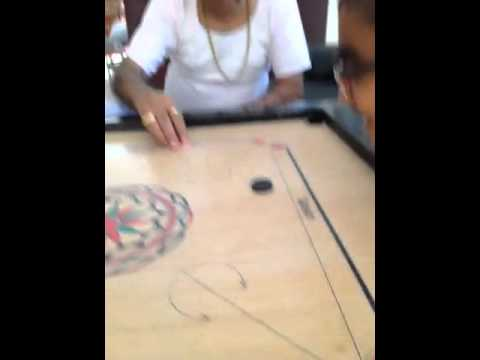 Pitamber nagji Parmar trying his hand at Carrom