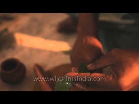 Applying sandalwood paste on bael leaves - A rituals of Maha Shivratri