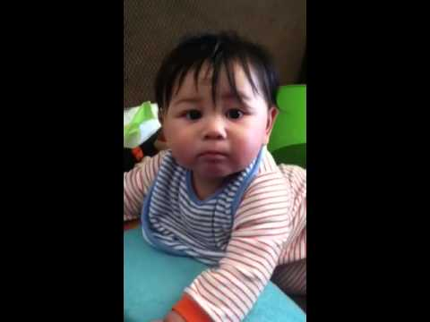 Baby gives stink face to