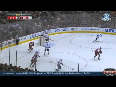 Big Hit - Chicago Blackhawks v Phoenix Coyotes - February 7 2014