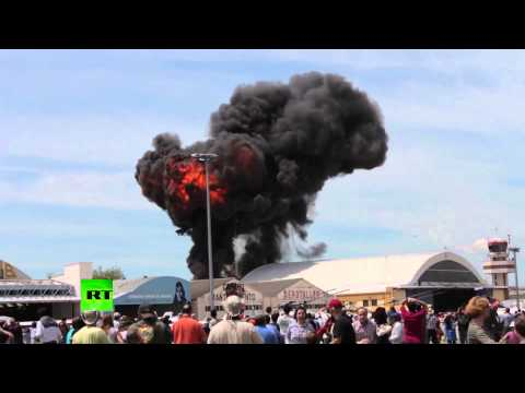 Dramatic footage: Vintage stunt plane crashes outside Madrid at aerobatics show